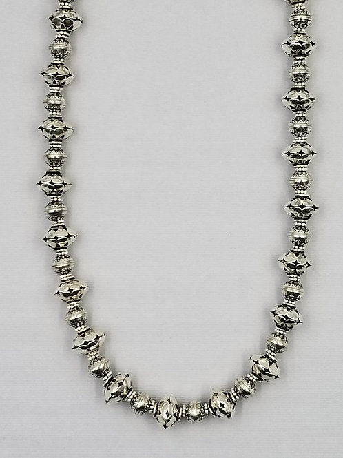 Sterling silver with large saucer-shape beads
