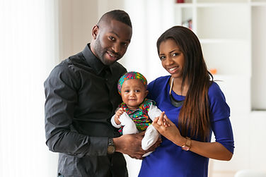 Adorable young black couple planning for their daughter's future