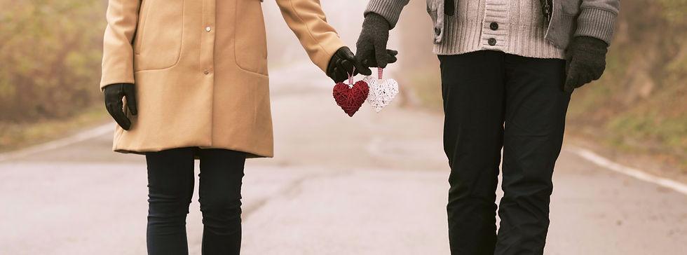 Couple Holding Hearts_edited_edited_edited.jpg