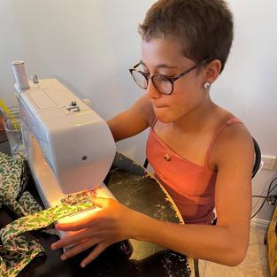 Miss A sews a headwrap