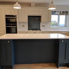 shaker kitchen with dark blue island uni