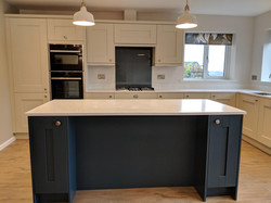 shaker kitchen with dark blue island uni