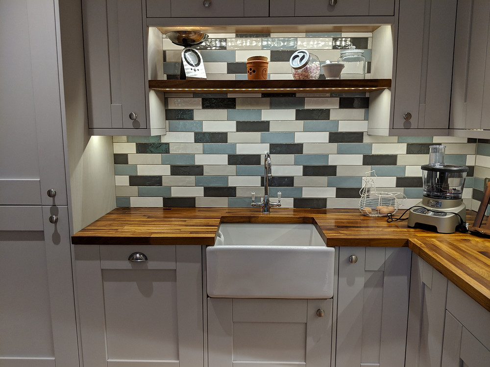 Belfast Sink Shoots from the hip, complimenting the blue, grey, ivory and cream tones in this family kitchen