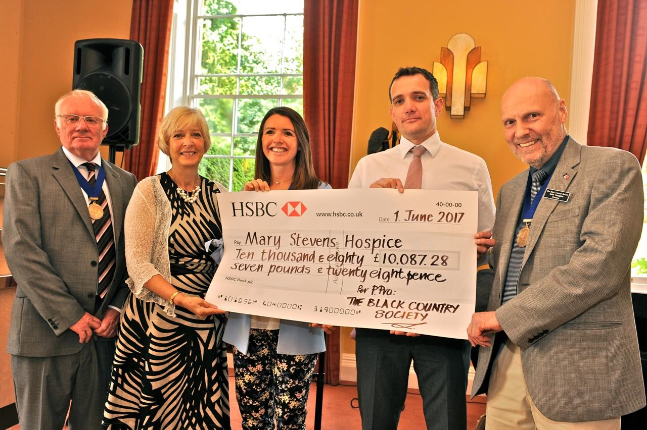 BCS presents Hospice Cheque at 50th Anniversay Event