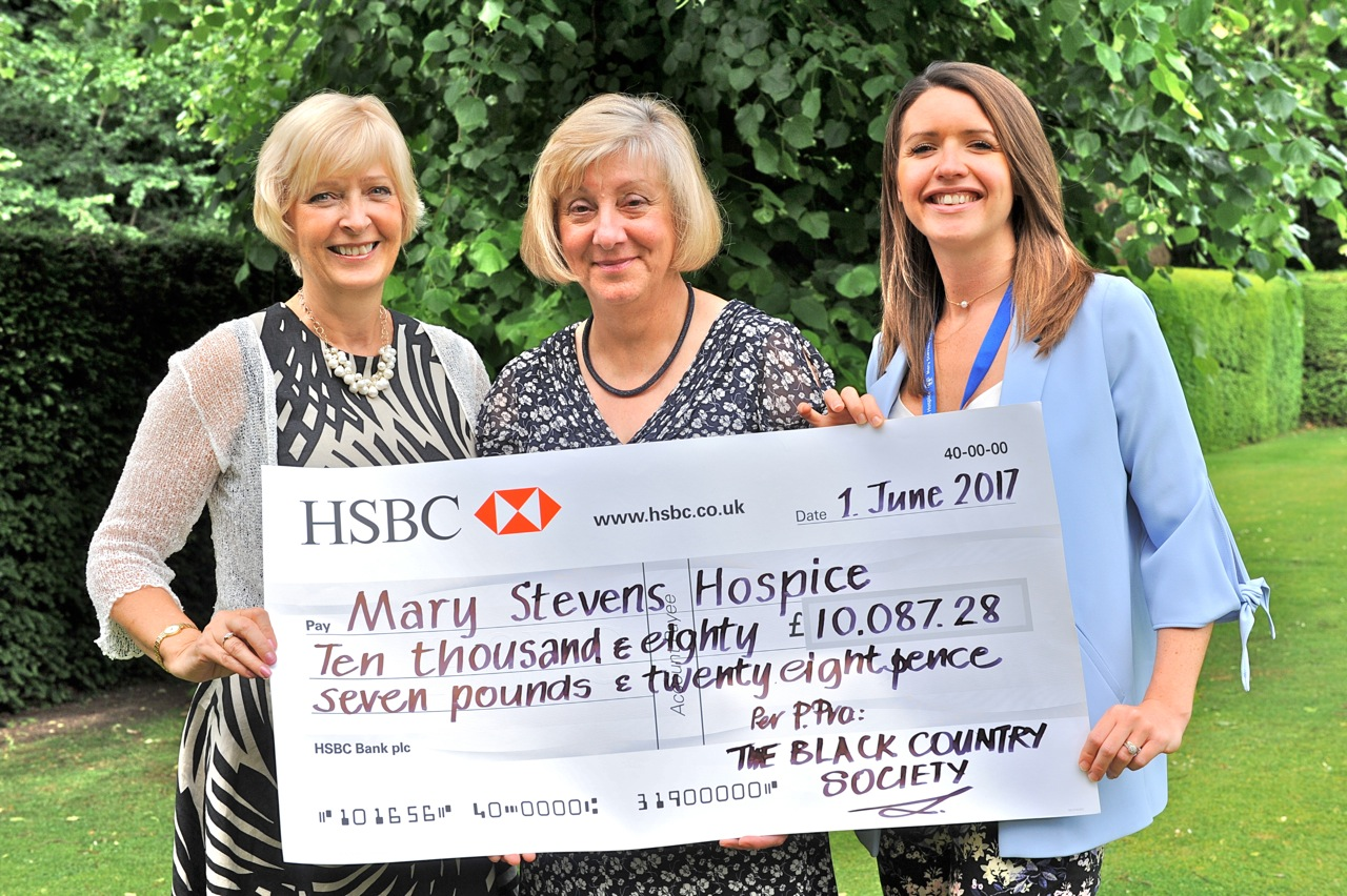 Val Mundon with donation cheque for Mary Stevens Hospice