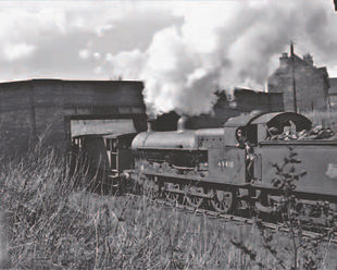 In the summer of 1960 `Super D` 49410 is about to pass under Horseley Road while banking a