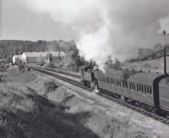 A Wolverhampton to Stourbridge Junction local train heads towards Dudley having just depar