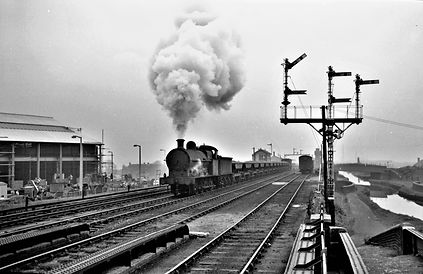 `Super D` 49377 trundles through Dudley Port with a ballast train in April 1961, with Telf