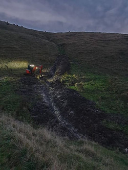 Finishing up a spring drain in Okains