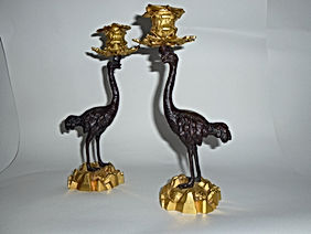 Fine pair of regency bronze and ormolu ostrich candle holders after Thomas Abbot