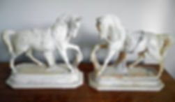 A matching pair of horse bronzes on marble base signed Andre