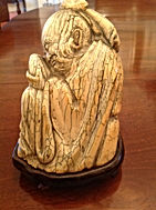Fine chinese Mamouth tusk carving of sage holding peach