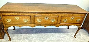 GeGeorge III oak three draw dresser base on cabriole legs