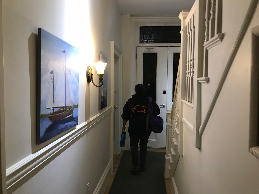 Heading to the room in the West House of the Salem Inn.