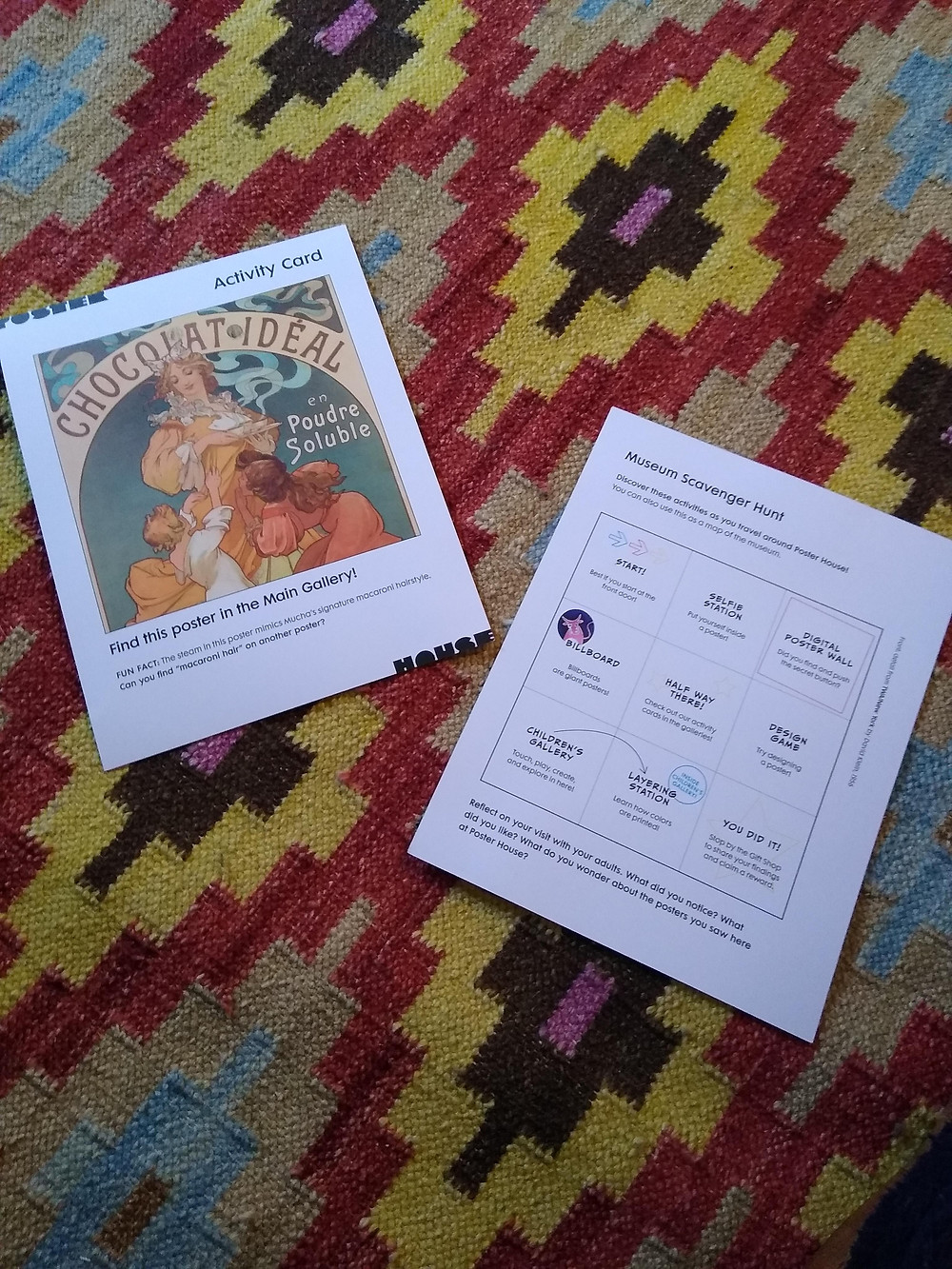 2 activity cards on carpet with zigzag design. Card on left has Mucha's chocolate poster and card on left has 3x3 grid
