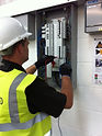 Electrician working on three phae distribution board