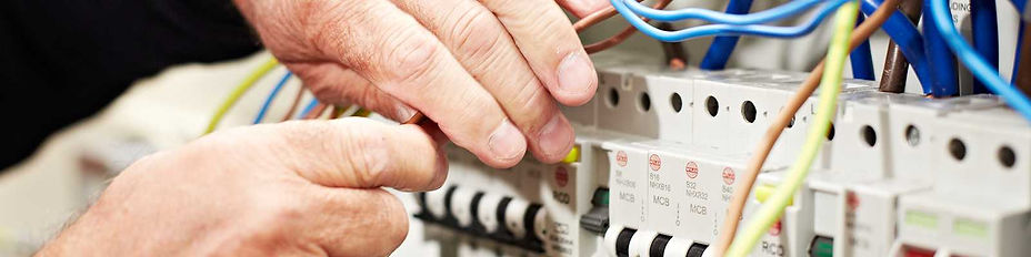 Electrician cabling a distribution board prior to Electrical Inspection and Testing.