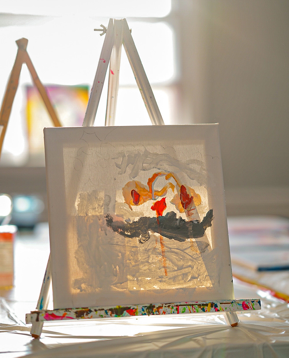 photo of a canvas painted by a 3 year old boy