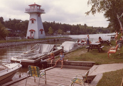 Lighthouse at Nancy Island and the boat docking area at Hollywood Cottages