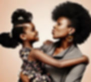 Mother and daughter with afro-textured hair