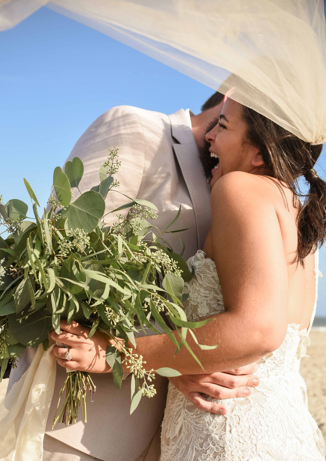 Happy Couple During a Beach Wedding