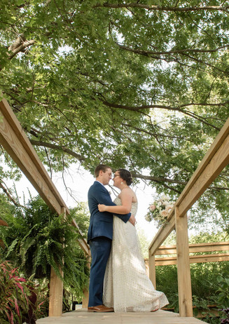 Couple Embracing on a Ramp in a Garden