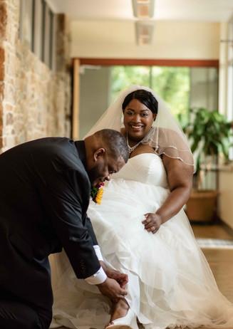 Husband Helping His Wife Put on Her Wedding Shoe