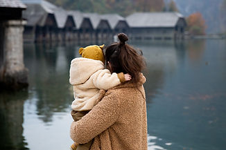 photo-of-woman-carrying-baby-3933409.jpg