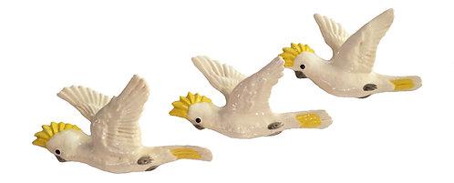 3 Flying Cockatoos