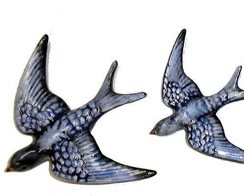 3 Flying Blue Swallows