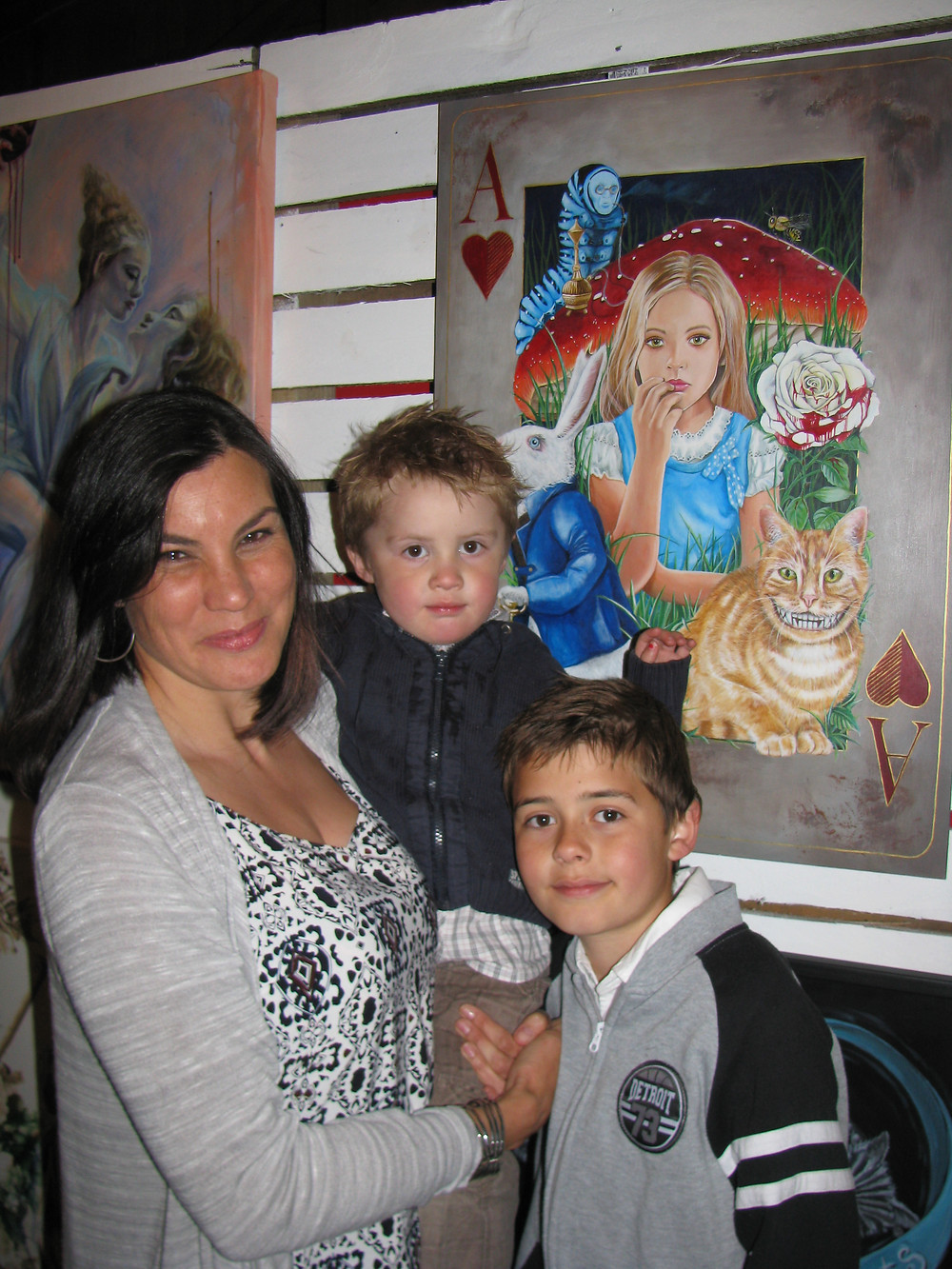 My two boys and I in front of my painting 'Wonderland'