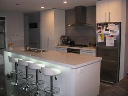 Kitchen floor and splashback.