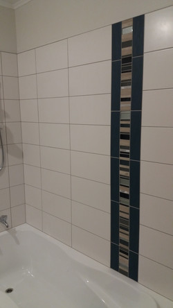 Mosiac insert in shower.