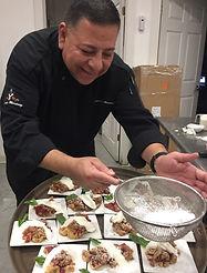 Chef plating dessert.JPG