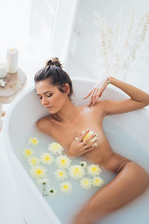Canva - Nude Woman Lying in Bathtub With