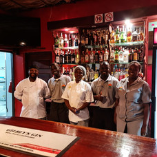 A photo of our staff standing at our bar.