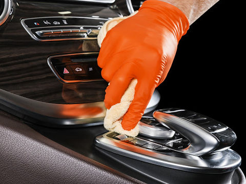bigstock-A-Man-Cleaning-Car-With-Microf-