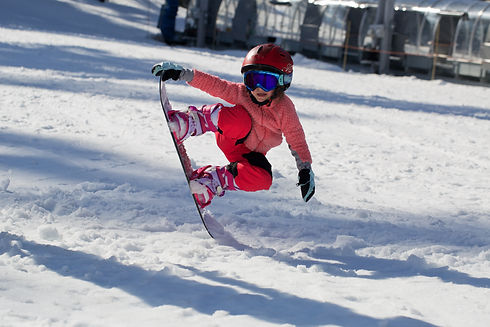 Little Cute Girl Snowboarding  making a