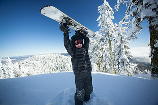 Youth snowboarder excited about the day.