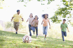five-young-friends-playing-soccer-5944482