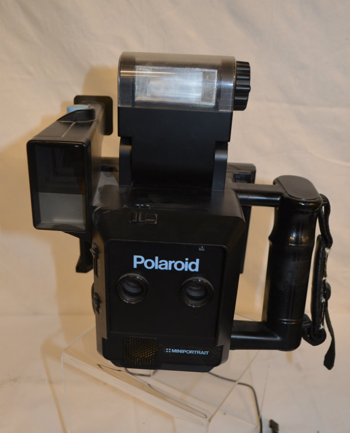 Polaroid Miniportrait camera with rigged flash