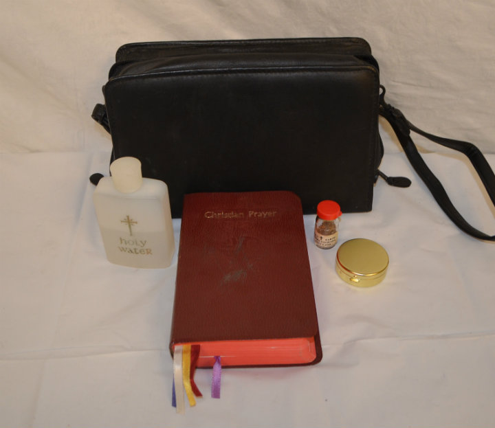 Priests carry kit