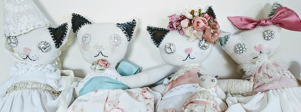 A bevy of pretty kitty dolls.  Cloth dols made of fine vintage fabrics and materials.