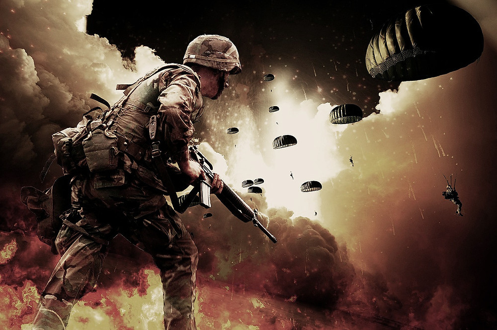 A soldier with a gun and parachuting soldiers landing amid explosions