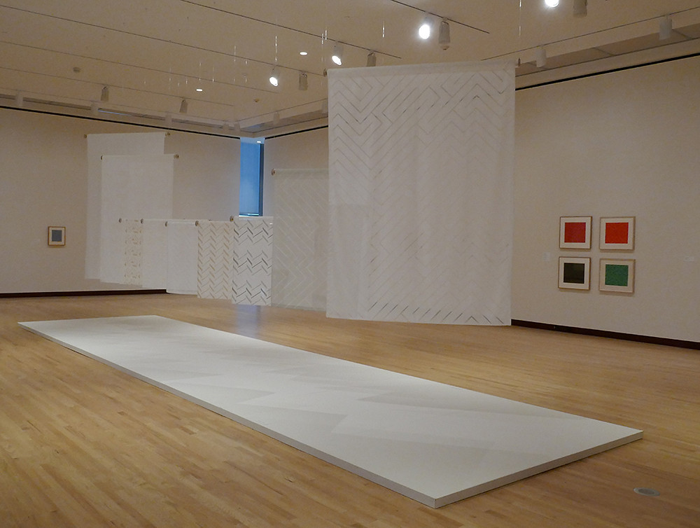 The well-designed gallery lighting even made shadow triangles on the floor from the translucent bolts of industrial cloth, woven from Anni Albers designs.