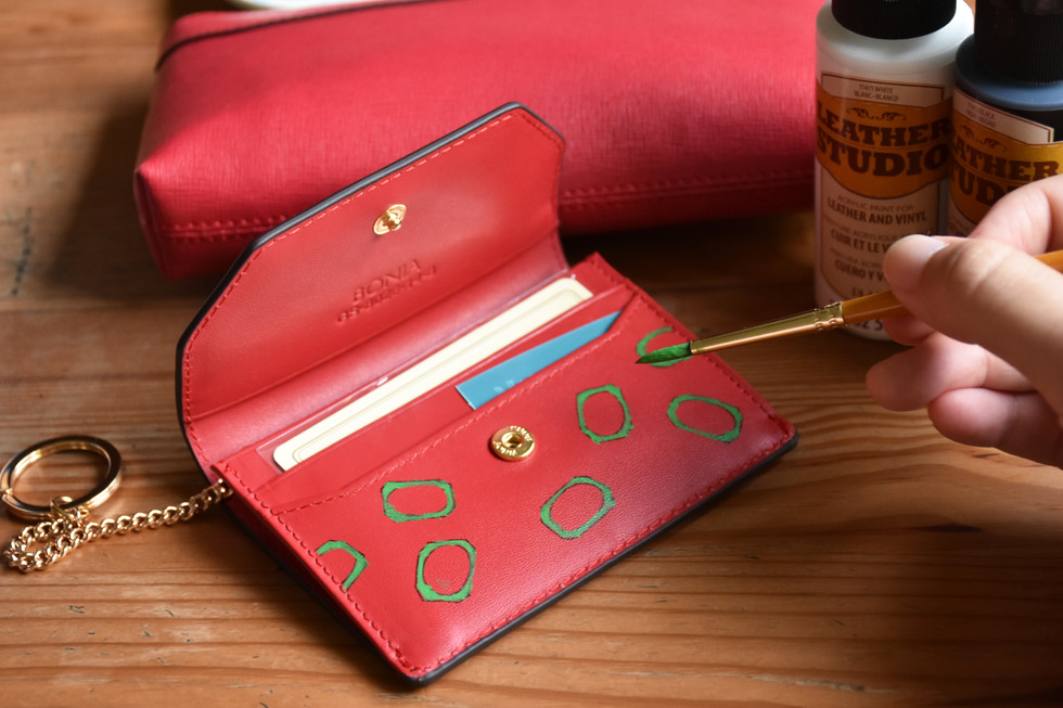 Now painting the underlying leather of the wallet