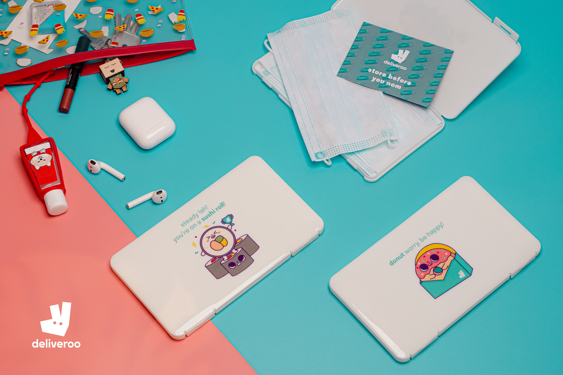 Flat lay photograph of mask cases with Laugh And Belly illustrations