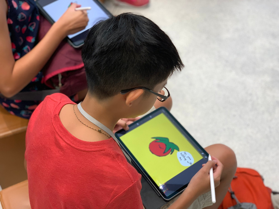 A boy doodling a tomato and pun