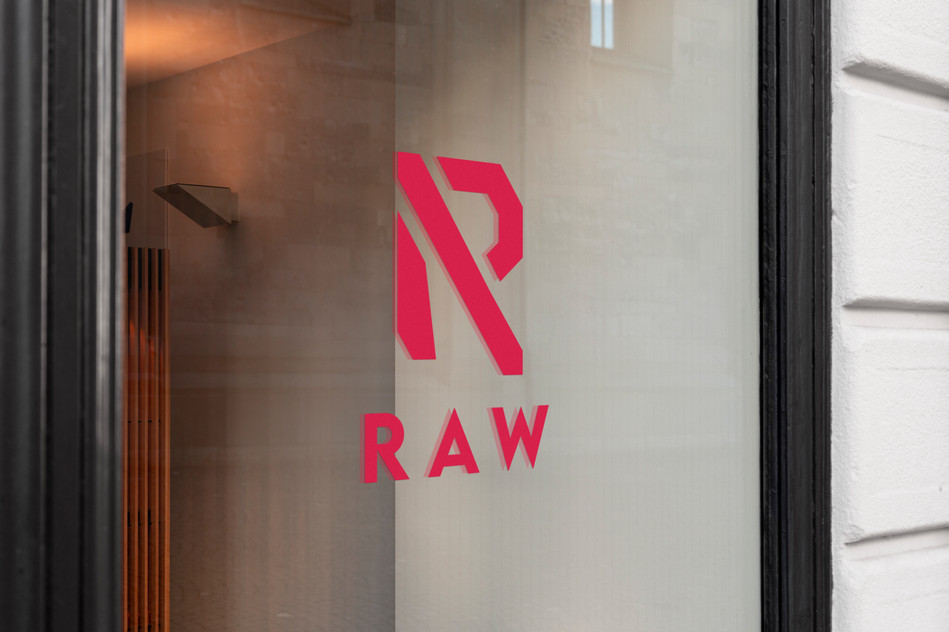 RAW logo printed on vinyl, pasted on the anti-gym's window.