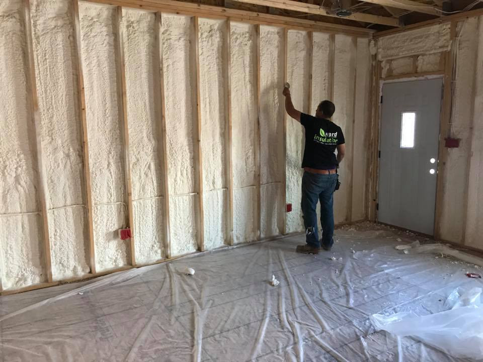 Insulation being performed in home